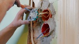 Electrician is installing new electric sockets Footage