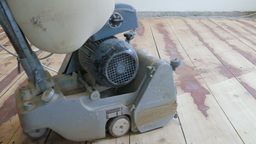 Floor sanding. Sanding machine is removing old surface Footage