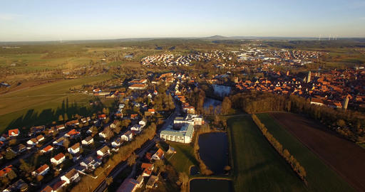 4K Aerial, Flight over landscape around small village in germany Footage