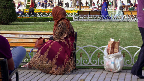 A woman is resting on a bench in the center of Istanbul. 4K Footage