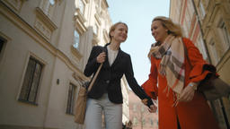 Two Girlfriends are Walking around the City, Laughing and Hugging in Slow Motion Footage