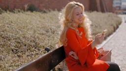 Cute Blonde Lady Smiling and Texting in Social Media with Smartphone Outdoor Footage