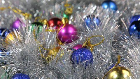Close-up of a rotation of multi-colored Christmas balls. Christmas background Footage