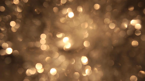 Rotating bokeh from golden tinsel. Christmas and new year background Footage
