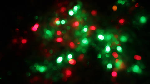 Zoom multicolored bokeh lights. Christmas and new year lights twinkling Footage