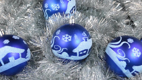 Close-up of a rotation of blue Christmas balls. Christmas background, tinsel Footage