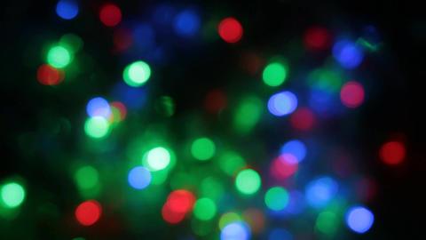 Rotating multicolored bokeh lights. Christmas and new year lights twinkling Acción en vivo