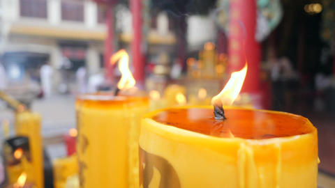 Burning Candles near Buddhist Temple. Thai Religion Background Concept. 4K Flame Footage