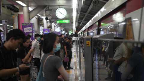 Bangkok, Thailand - 21 OCT 2017: People Waiting for Metro Train Doors to Open At Footage