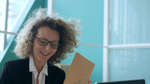 Young Smiling Business Woman Throwing Papers and Having Fun with Colleagues in Footage