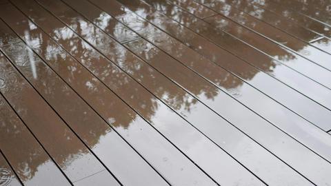 Rain Drops Dripping on the Eooden Floor. Tropical Rainy Season in Thailand Footage