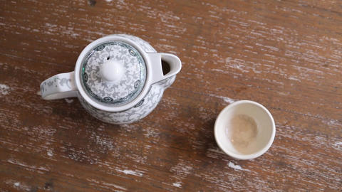 Slow Motion of Pouring Healthy Green Tea from Vintage Teapot in Cup on the Footage