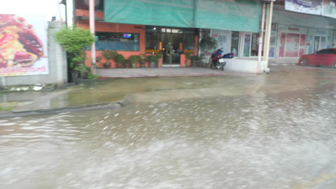 Heavy Rains in Flooding Bangkok, Thailand. Car Driving Deep Water Puddles in Footage