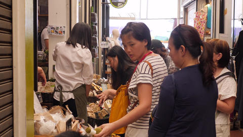 Tourists Shopping and Buying Cosmetics at Famous Chatuchak Weekend Market Footage