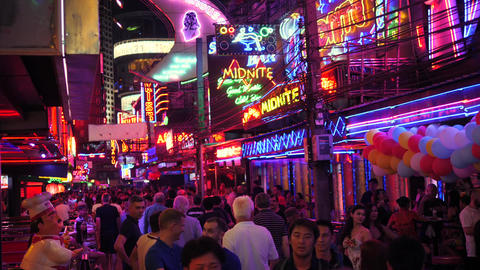 Tourists Walking at Red Lights Soi Cowboy Street. Sexual Tourism in Asia Concept Footage