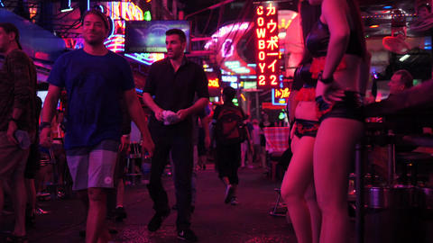 Thai Bar Girls at Soi Cowboy Street. 4K. Popular Red District for Sexual Tourism Footage