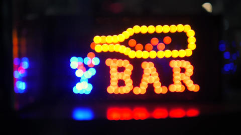 Flashing Night Bar Led Sign with Beautiful Unfocused Bokeh Effect. 4K. Bangkok Footage