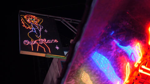 Colorful Neon Lightings at Soi Cowboy - Popular Sexual Tourism Street. 4K Footage