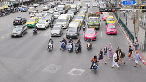 Motorbikes and Cars at Busy Traffic Road near Asok BTS Subway Train Station. 4K Footage