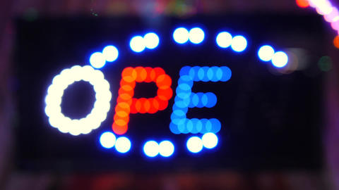 Blinking Led Open Shop Street Bar Door Sign with Beautiful Blurry Bokeh. 4K Footage