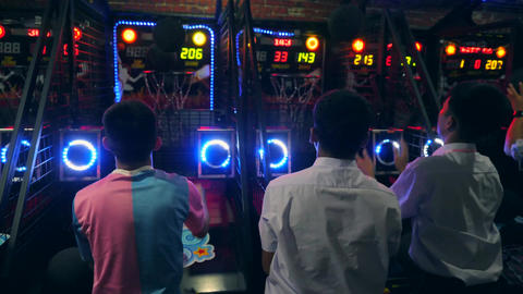 Tourists Playing Basketball and Throwing Ball at Arcade Machine in Game Zone MBK Footage