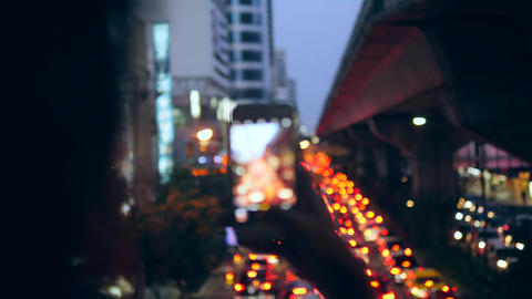 Young Hipster Tourist Girl Takes Smartphone Picture in Night Bangkok City Car Footage