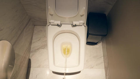 Man Pees in the Toilet. Urinal in Restroom Flushed. 4K Footage