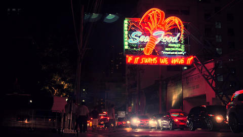 Flashing Big Lobster Neon Sea Food Restaraunt Street Sign. NOV 05 2017 - Bangkok Footage