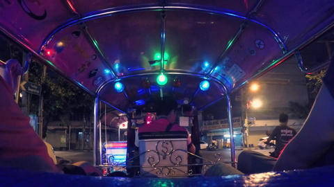 Tourists Riding Tuk-Tuk driving at Night Streets. Popular Three-Wheeled Footage