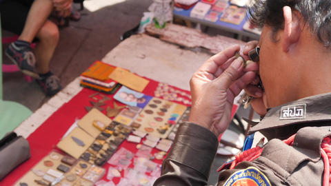 Thai Asian Man Choosing Vintage Buddhist Pendant Lucky Amulet at Chatuchak Footage