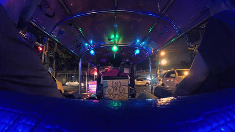 4K Time Lapse: Tourists Riding Tuk-Tuk driving at Night Streets. Popular Three Footage