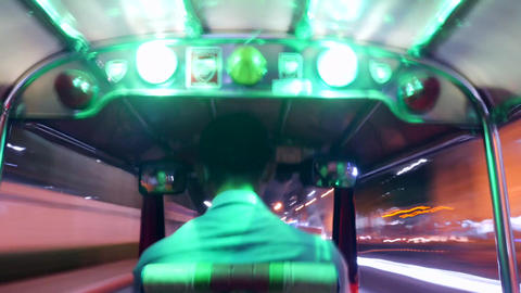 Time Lapse: Tourists Riding Tuk-Tuk driving at Night Streets. Popular Three Footage