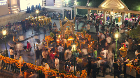 The Erawan Shrine Statue Temple at Ratchaprasong Intersection and Asian People Footage