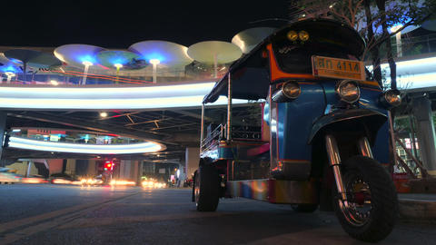 4K Time lapse: Traditional Thai Tuk-tuk Moto Taxi. Busy Night Street near Footage