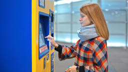 Young Woman is Buying a Ticket in Vending Machine, Choosing on Touch Screen Footage