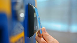 CloseUp of Paying by a Credit Card using PayPass Reader on a Vending Machine Footage