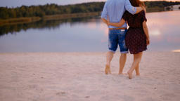 Young Couple Running on Sand on the Beach to Forest Picturesque Lake at Sunset Footage