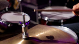 Drummer is Playing Fast Music on Drums at Concert in Nightclub with Cute Light Footage