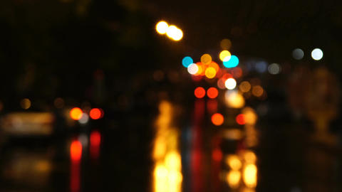 Defocused view of the Night city in the lights of street lamps and cars Footage