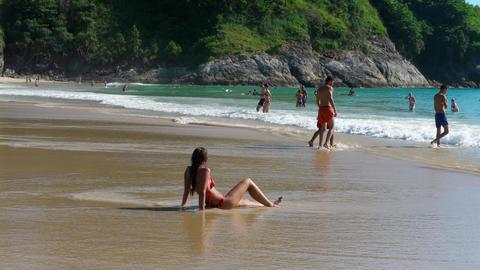 Tourists on Nai Harn beach Footage