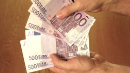 Man counting five hundred euro banknotes. Savings, salary or spending concepts Footage