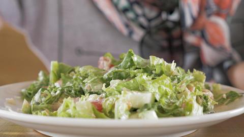 Young girl eats salat Footage