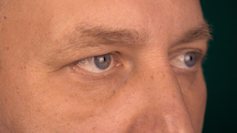 A fixed view of a man from a close distance. Male eyes look at the same point Footage