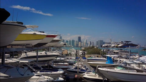 Boats Stacked and Parked in a Storage Area by the Ocean with Downtown Miami Footage