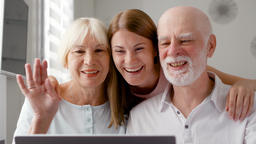 Senior couple and their daughter sitting at home talking via messenger Skype Footage