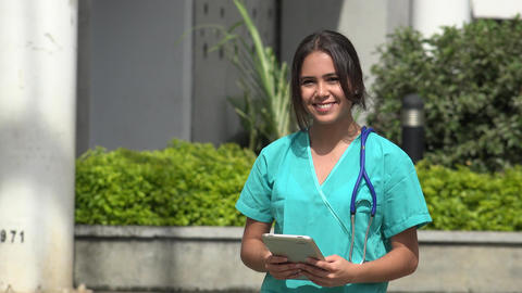 Happy Female Nurse With Tablet Live Action