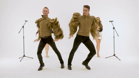 Actors of the ballet, two girls two guys dancing in the studio on a white Footage