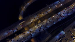 Aerial top down view of highway traffic in the evening rush hour Footage