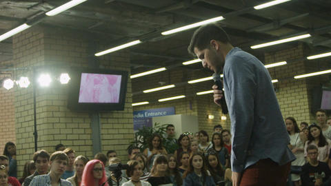 Slow Motion Guy Makes Speech in front of Youth in Hall Live Action