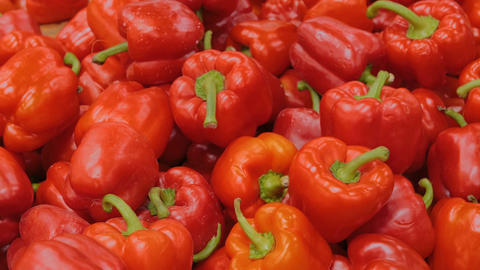 Woman buying fresh red bell peppers at grocery store Footage